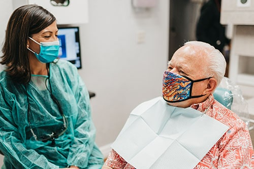 One of our dental assistants working with a patient
